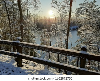 Winter walk in a breathtaking scenery. Sunset by the lake.