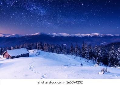 The Milky Way over the winter mountains landscape. Carpathian, Ukraine, Europe. Beauty world.