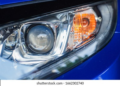 A close-up of a car projector headlight