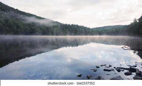 A scenic foggy view of Little Rock Pond along the Long Trail in Vermont.
