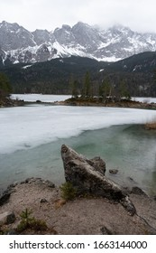 A breathtaking view of Zugspitze lake surrounded with forests in Eibsee lake near Garmisch-partenkirchen in winter