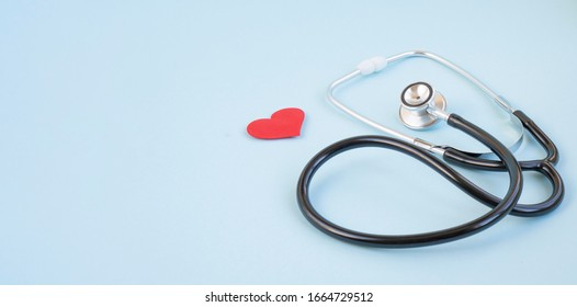 Stethoscope and red heart on a blue background. Greeting background. National doctor's day. Happy nurse 's day. Health day. Top view, a copy of the space. Thank you doctors and nurses .