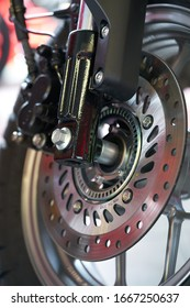 Close-up of motorcycle brakes and front wheel
