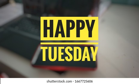 Happy tuesday word with blur background picture laptop and handphone.