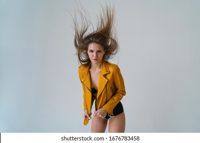 Young fair-skinned girl with long flying hair posing in the studio. wide angle lens and look at the camera.
