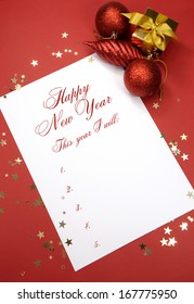 Happy New Year resolutions writing on notepad paper, This year I will, list of goals against a red background with festive decorations.