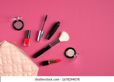 Makeup cosmetic bag organizer with beauty products and professional make-up artist tools on pink background. Flat lay, top view. Beauty and fashion concept.