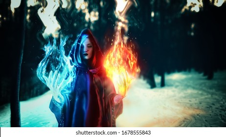 Cosplay, fantastic, artistic photo processing. A girl in a black robe, from her hands comes a fire of  turquoise and dark yellow and red. Dark magic forest.