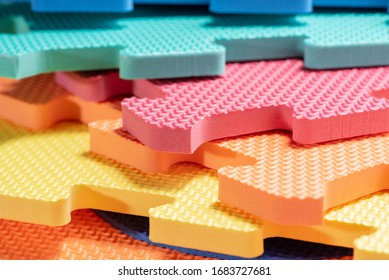Macro photo of the details of a foam eva. Colored rubber mat puzzle for children.