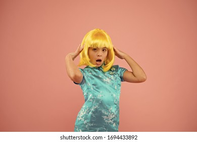 Girl yellow wig. Cosplay character concept. Japanese style. Eastern trends for teens. Hobby and entertainment. Pop culture. Anime fan. Child cute cosplayer. Anime emotional expression. Anime admirer.