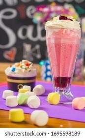 blackberry milkshake decorated with marshmello