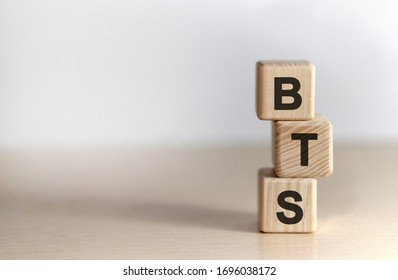 BTS - text on wooden cubes, on white background