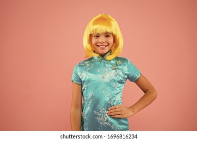 Eastern trends for teens. Pop culture. Anime fan. Cosplay kids party. Child cute cosplayer. Cosplay outfit. Otaku girl wig smiling pink background. Cosplay character concept. Hobby and entertainment.