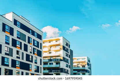 Detail in Modern residential flat apartment building exterior. Fragment of New luxury house and home complex. Part of City Real estate property and condo architecture. Copy space. Blue sky