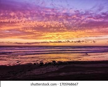Sonnenuntergang am Ninety Mile Beach, Northland, Neuseeland
