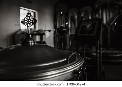 Cross silhouette on altar near window in dark empty old chapel. Game of light and shadow in church. Religious christian background. Despair and hope, divine mercy, god love concept. Black white photo