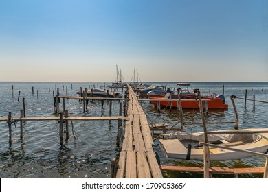 Old wood boats pier. Little wooden platform for boat and speedboat at sea marina