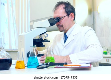 Chemist crazy. A mad scientist conducts experiments in a scienti