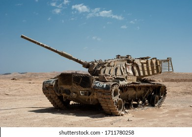 desert landscape with tank and blue sky