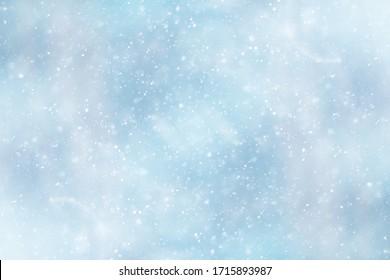 blauwe sneeuwval bokeh achtergrond, abstracte sneeuwvlok achtergrond op wazig abstract blauw