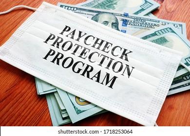 PPP Paycheck Protection Program als SBA-Darlehen auf der Maske und Geld geschrieben.