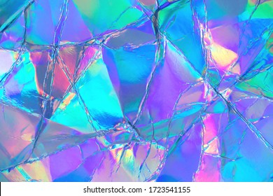 Verschwommener abstrakter moderner pastellfarbener holographischer Hintergrund im Stil der 80er Jahre. Zerknitterte schillernde Folie echte Textur. Synthwave. Vaporwave-Stil. Retrowave, Retro-Futurismus, Webpunk