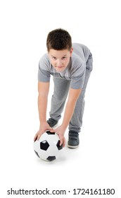 Full length portrait of a child in sportswear with a soccer ball. The child dreams of becoming a football player. Isolated on white background