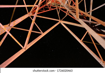 Telephone tower at night in the country