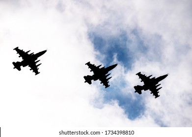 silhouettes of military aircraft in the sky at a parade