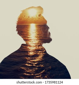 Double exposure portrait of a man in contemplation at sunset time