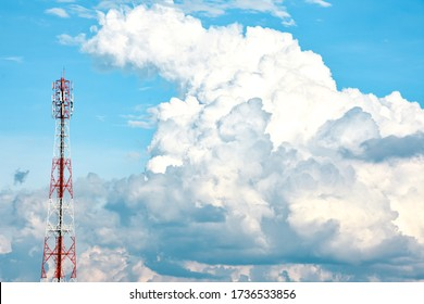 Telecommunication tower with beautiful blue sky with white clouds. Anime sky clouds, anime style. Dramatic white clouds and sky background for animation or designer.