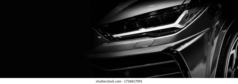 Detail on one of the LED headlights super car.copy space
