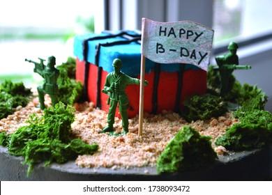 Pubg game themed birthday cake closeup. Cake for gamer. Military themed birthday cake