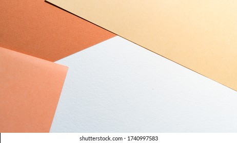 Color papers geometry shape composition background with white beige copper and brown color tones. Minimalism geometric flat lay backdrop. Top view