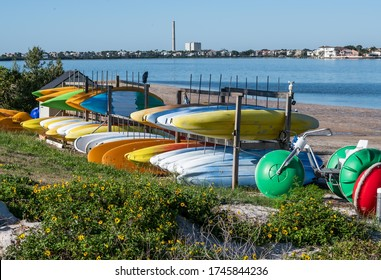 Toys for Big Boys on the Beach at Anclote Key, Florida, consisting of canoes, paddle boats, pedal bikes, and kayaks