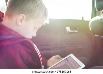 Boy on tablet pc
