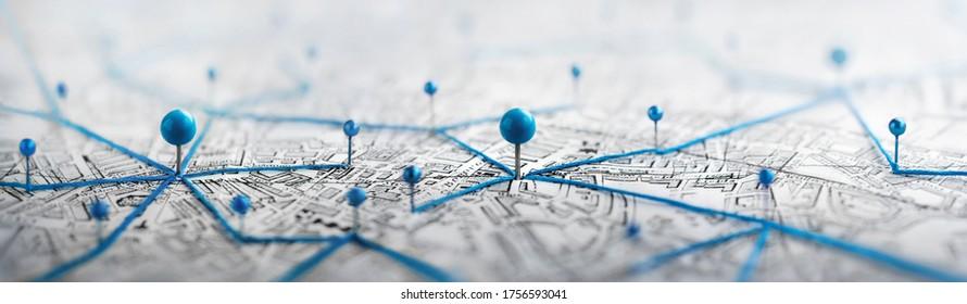 Ortsmarkierung mit einer Stecknadel auf einer Karte mit Routen. Finde deinen Weg. Abenteuer, Entdeckung, Navigation, Kommunikation, Logistik, Geographie, Transport und Reisethema Konzept Hintergrund.