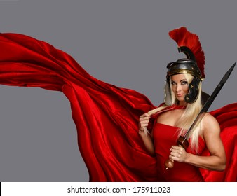 Muscled blonde in a centurion helmet