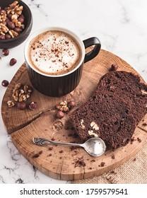 Chocolate walnut brownie served with coffee.