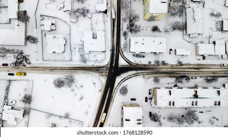Aerial view of a snowy road in poor regions of Ukraine, in a village in winter.