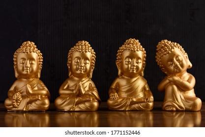 El pequeño Buda de oro. El Buda, también conocido por su nombre real como Siddhartha Gautama, fue el fundador del budismo y nació en la antigua India. Esta imagen muestra un Buda en miniatura meditando.