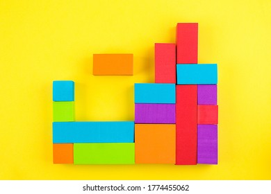 Kids designer of multi-colored volumetric 3d geometric shapes on a yellow background. Logical educational game.