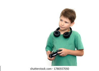 Boy plays a computer game with headphones and a joystick, game console.