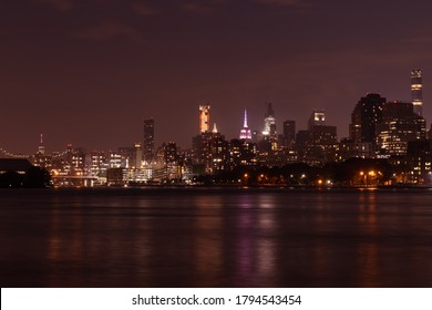 Nighttime Roosevelt Island and Manhattan Skyline along the East River in New York City