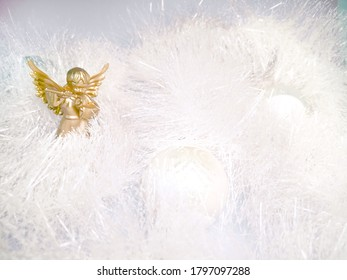 golden angel on a light background in the new year