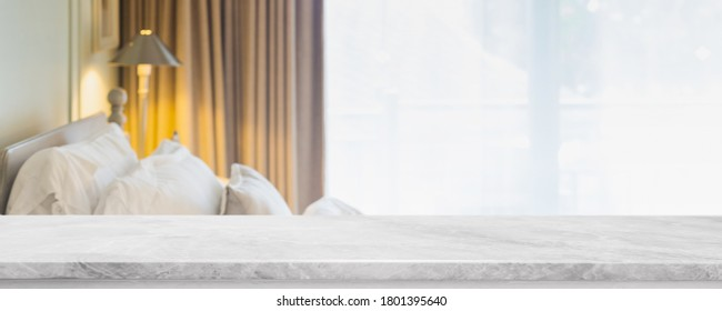 Empty white marble stone table top and blurred living room in home interior with curtain window background. - can used for display or montage your products.