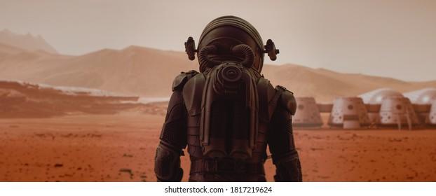 Rückansicht des Astronauten, der Raumanzug trägt, der auf einer Oberfläche eines roten Planeten geht. Marsbasis und Rover im Hintergrund. Mars-Kolonisationskonzept