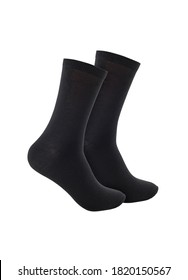 Black color socks isolated on white background. One pair of socks. Set of black socks for sports on foot as mock up for advertising, branding, design mockup, isolated, clipping path.