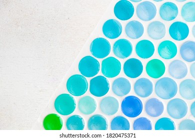 Colorful and multicolored honeycomb background, green and blue colors gradient in circles