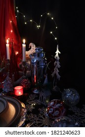The Christmas table with a leprechaun hidden behind a tree and white candles